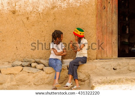 OMO, ETHIOPIA - SEPTEMBER 21, 2011: Unidentified Ethiopian girls near a house. People in Ethiopia suffer of poverty due to the unstable situation - stock photo