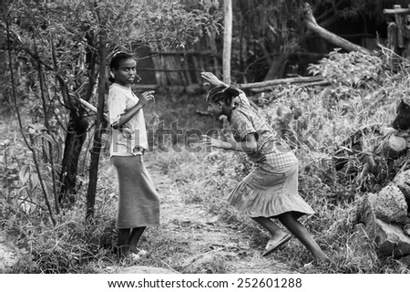 OMO, ETHIOPIA - SEPTEMBER 19, 2011: Unidentified Ethiopian girls play together. People in Ethiopia suffer of poverty due to the unstable situation