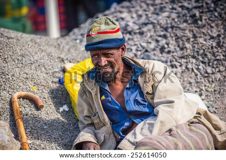 OMO, ETHIOPIA - SEPTEMBER 21, 2011: Unidentified Ethiopian man in the street. People in Ethiopia suffer of poverty due to the unstable situation
