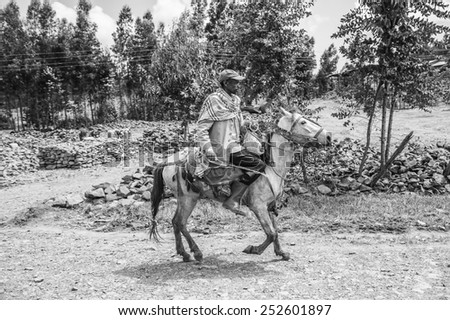 OMO, ETHIOPIA - SEPTEMBER 19, 2011: Unidentified Ethiopian man rides a horse. People in Ethiopia suffer of poverty due to the unstable situation
