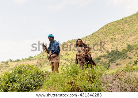 OMO, ETHIOPIA - SEPTEMBER 21, 2011: Unidentified Ethiopian man, woman and a little girl. People in Ethiopia suffer of poverty due to the unstable situation
