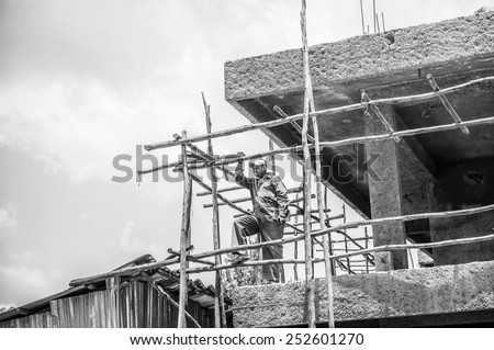 OMO, ETHIOPIA - SEPTEMBER 21, 2011: Unidentified Ethiopian man works in construction. People in Ethiopia suffer of poverty due to the unstable situation