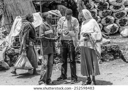 OMO, ETHIOPIA - SEPTEMBER 21, 2011: Unidentified Ethiopian men buy something. People in Ethiopia suffer of poverty due to the unstable situation