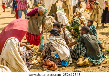 OMO, ETHIOPIA - SEPTEMBER 19, 2011: Unidentified Ethiopian people at the local market. People in Ethiopia suffer of poverty due to the unstable situation