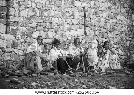 OMO, ETHIOPIA - SEPTEMBER 21, 2011: Unidentified Ethiopian people in white tissue in the street. People in Ethiopia suffer of poverty due to the unstable situation