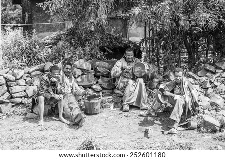 OMO, ETHIOPIA - SEPTEMBER 19, 2011: Unidentified Ethiopian people near a house. People in Ethiopia suffer of poverty due to the unstable situation