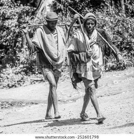 OMO, ETHIOPIA - SEPTEMBER 21, 2011: Unidentified Ethiopian two men portrait. People in Ethiopia suffer of poverty due to the unstable situation