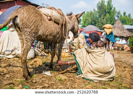 OMO, ETHIOPIA - SEPTEMBER 19, 2011: Unidentified Ethiopian woman and little baby and their donkey. People in Ethiopia suffer of poverty due to the unstable situation