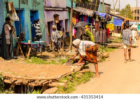 OMO, ETHIOPIA - SEPTEMBER 19, 2011: Unidentified Ethiopian woman in the street. People in Ethiopia suffer of poverty due to the unstable situation
