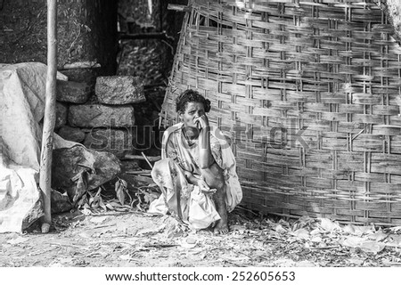 OMO, ETHIOPIA - SEPTEMBER 19, 2011: Unidentified Ethiopian woman thinks of something. People in Ethiopia suffer of poverty due to the unstable situation