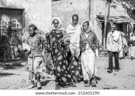 OMO, ETHIOPIA - SEPTEMBER 21, 2011: Unidentified Ethiopian women walk in the street. People in Ethiopia suffer of poverty due to the unstable situation