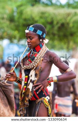 OMO VALLEY, ETHIOPIA - AUG 15: Hamer woman in the Turmi market, the ethnic groups in the Omo valley could disappear because of Gibe III hydroelectric dam on Aug 15, 2011 in Omo Valley, Ethiopia. - stock photo