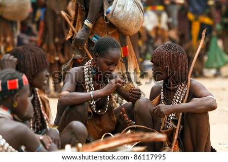 OMO VALLEY, ETHIOPIA - AUG 15: Hamer women  in the Turmi market, the ethnic groups in the Omo valley could disappear because of Gibe III hydroelectric dam on Aug 15, 2011 in Omo Valley, Ethiopia.