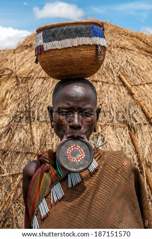 OMO VALLEY, ETHIOPIA - MARCH 16,2014 - The Mursi are a Nilotic pastoralist ethnic group that inhabits southwestern Ethiopia. The home of the Mursi is one of the most isolated regions of the country. - stock photo