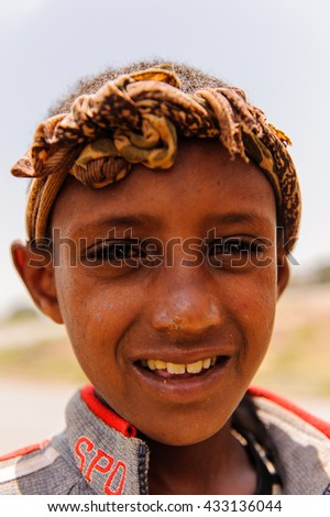 OMO VALLEY, ETHIOPIA - SEP 19, 2011: Portrait of an unidentified Ethiopian boy in Ethiopia, Sep.19, 2011. People in Ethiopia suffer of poverty due to the unstable situation