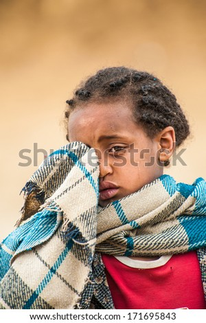 OMO VALLEY, ETHIOPIA - SEP 22, 2011: Unidentified Ethiopian girl cries in front of the camera in Ethiopia, Sep.22, 2011. People in Ethiopia suffer of poverty due to the unstable situation