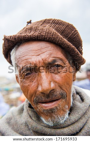 OMO VALLEY, ETHIOPIA - SEP 22, 2011: Unidentified Ethiopian man wearing a hat in Ethiopia, Sep.22, 2011. People in Ethiopia suffer of poverty due to the unstable situation