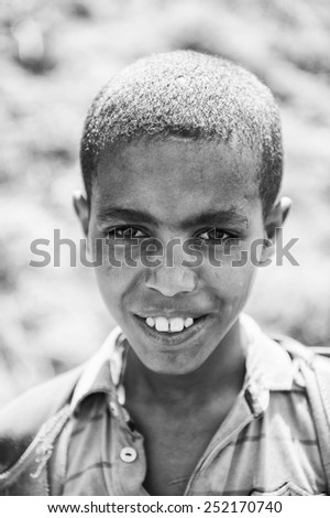 OMO VALLEY, ETHIOPIA - SEP 22, 2011: Unidentified Ethiopianboy smiles for the camera  in Ethiopia, Sep.22, 2011. People in Ethiopia suffer of poverty due to the unstable situation