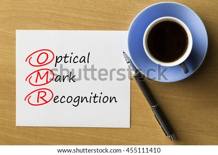 OMR Optical Mark Recognition - handwriting on paper with cup of coffee and pen, acronym business concept