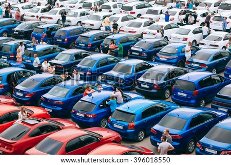 Omsk, Russia - August 22, 2014: Country flag automobile flashmob. Close up view of red, blue and white cars