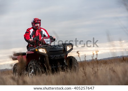 Omsk, Russia - August 30 , 2015: man on quad ATV in the field