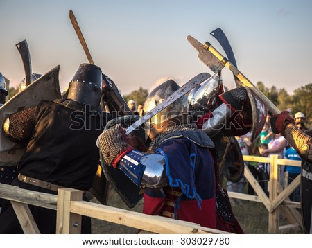 "OMSK, RUSSIA - AUGUST 1, 2015: Unidentified participants in medieval fight at a historical reenactment festival ""shield of Siberia"" AUGUST 1, 2015, in Omsk, Siberia, Russia"