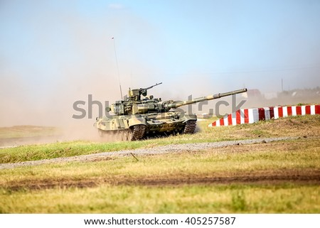 Omsk, Russia - July 07, 2011: International exhibition of high-tech equipment and weapons, tank on maneuvers, motion in cloud of dust