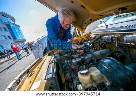 Omsk, Russia - June 11, 2013: stage of Rally Peking-Paris by retro cars in Siberia, Motor check