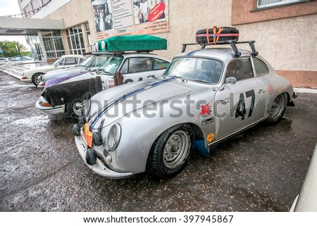 Omsk, Russia - June 11, 2013: stage of Rally Peking-Paris by retro cars in Siberia, silver car with spare wheel