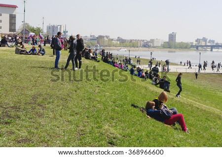 Omsk, Russia - May 09, 2012: crowd of people resting on Irtysh river embankment