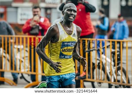 Omsk, Russia -  September 20, 2015: runs Kenyan Laban Kipkemoi Moiben, winner Siberian international marathon - stock photo