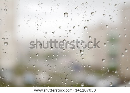 On a autumn raining day. Drops of water on the window. Shallow DOF - stock photo