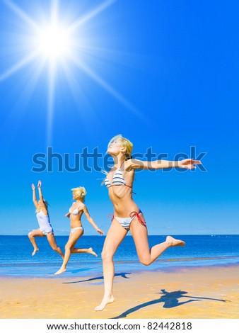 On a Beach Blonde Beauties - stock photo