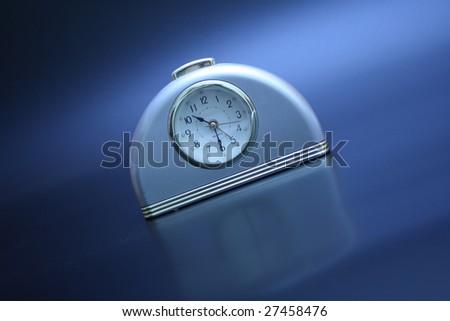 on a black background alarm clock - stock photo