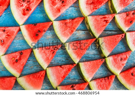 on a blue background flat triangles of watermelon/