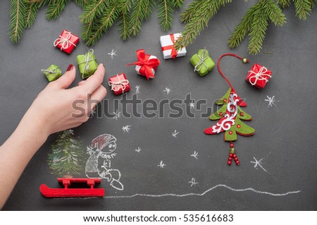 on a gray background fir branches, gifts, small fir.