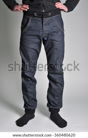 on a guy wearing jeans; view of the waist; guy in the jeans and socks