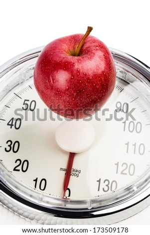 on a personal scale is an apple. symbolic photo for weight loss and healthy, vitamin-rich diet. - stock photo