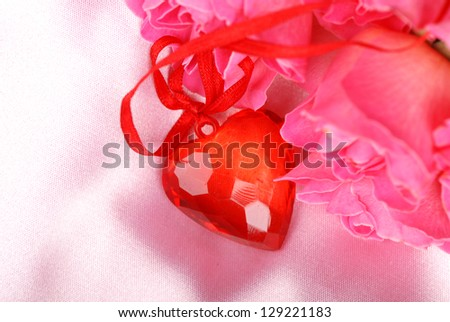 On a pink background red heart symbol/Romantic image of pink roses and red heart