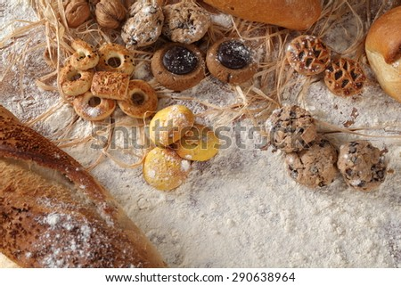 On a table a composition of biscuits and bread