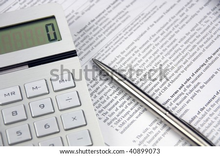 On a table the pen, the calculator, the contract - stock photo