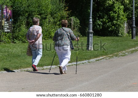 on a very sunny day in june in south germany you see seniority lady together