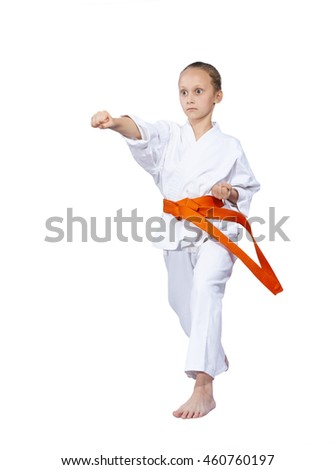 On a white background girl in karategi beats punch