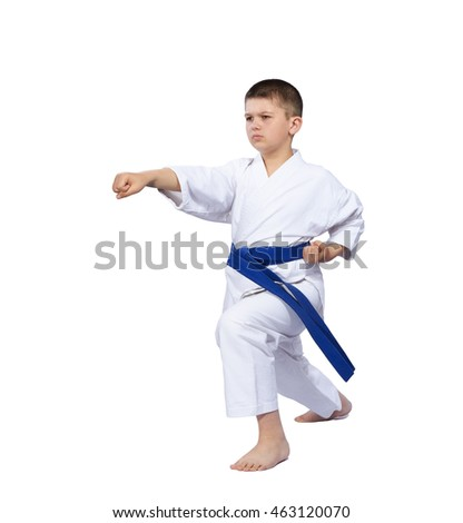 On a white background karate boy beats punch arm isolated