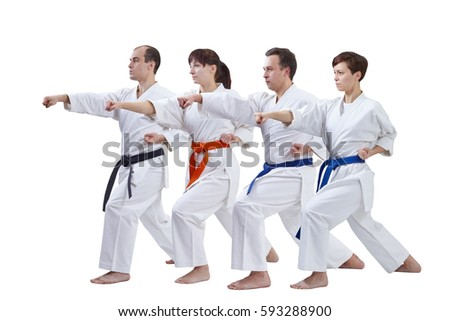 On a white background the athletes with different colors of belts are beating punch arm