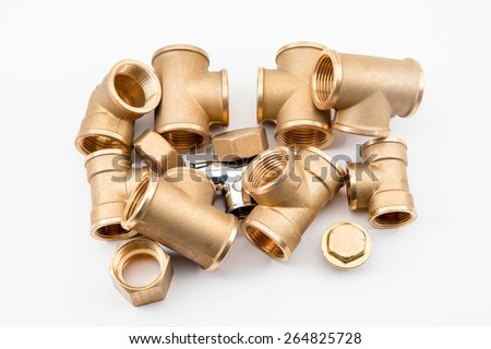 on a white background there are several copper fittings with a stop - stock photo