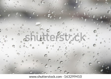 On a winter raining day. Drops of water on the window. Shallow DOF - stock photo
