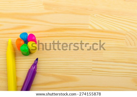 on a wooden table pencils, pen, marker, notepad, sticker - stock photo