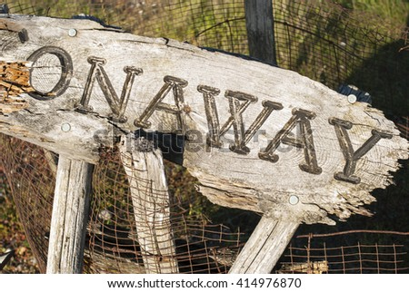 On Away. In-script on wooden background. Gone fishing. - stock photo