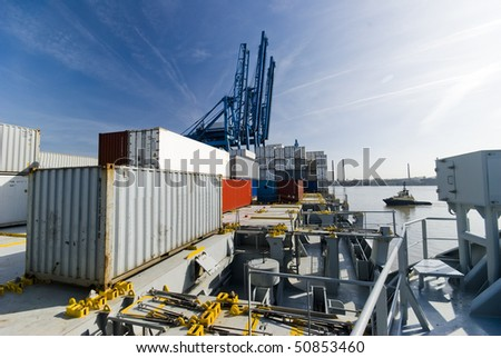 on-board container ship in port during cargo operation